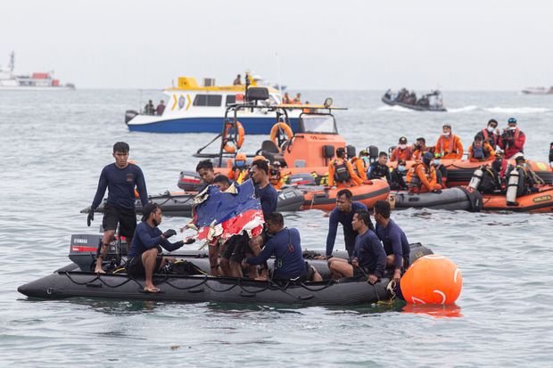 Indonesia Plane Crash Search Finds Human Remains, Life Vests and Aisle Sign